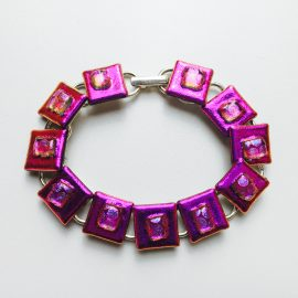 Bright pink and clear spotted dichroic glass on silver plated bracelet