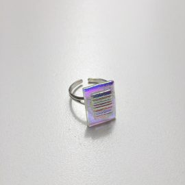 Clear dichroic blue/pink glass with stripe detail and adjustable sterling silver ring