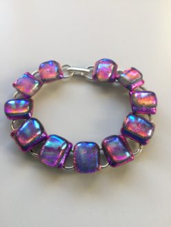 Pink dichroic glass bracelet on plated silver links. A charming and vibrant addition to any outfit.
