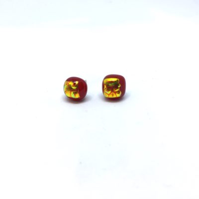Deep red square stud featuring gold detail with a ripple effect on sterling silver posts