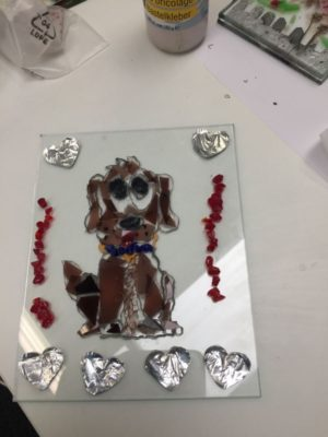 Chocolate labrador dog in glass