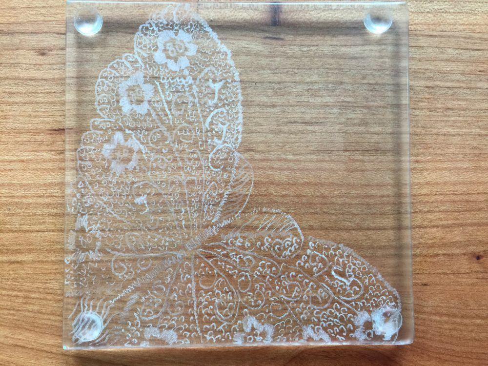 detail of glass butterfly engraved on glass