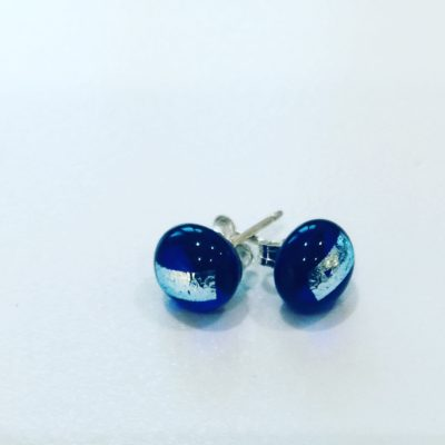 Round royal blue glass earrings with dichroic silver glass stripe detail.Mounted on sterling silver posts with sterling silver backs