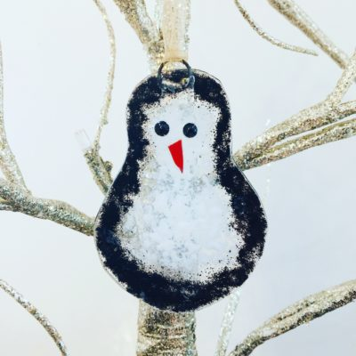 Perry Penguin fused glass hanging decoration in black and white glass. Made from recycled picture frame glass.